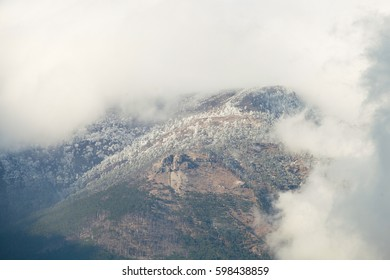 Atmospheric clouds of fog cover the top of the mountain. Crimea. Yalta. Ay Petrinskaya Yaila.