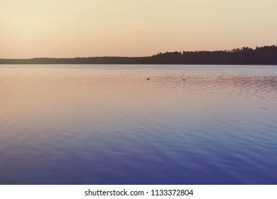 Atmospheric dusk over calm lake