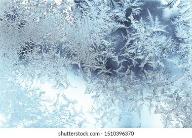 atmospheric ice flowers at the window as close-up in the back light
