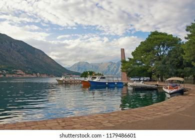 Atmospheric Mediterranean landscape. Montenegro, Bay of Kotor. View of embankment of Kotor city and Freedom Park