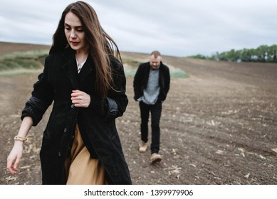 Atmospheric Portrait of a girl with a guy on the subject: parting, racking up, depression, longing, fear, loss, past in the field. Psychological portrait of the end of the relationship