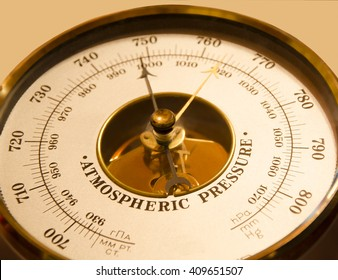 Atmospheric pressure of a barometer on a beige background weather atmospheric pressure climate weather