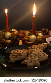 Atmospheric shoot of christmas eve with cookies and candles