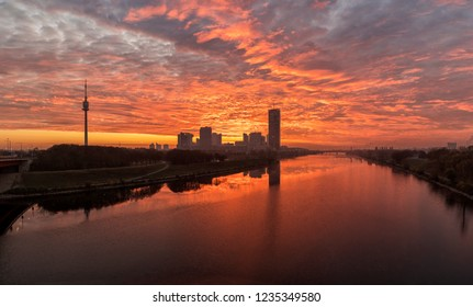 Atmospheric sunrise at the so called Danube Island in Vienna with the amazing skyline of Danube City at the Danube River - Austria. It's one of the most interesting extensive public recreation area in