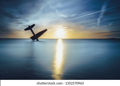 Atmospheric Sunset over a lake with long exposure and smooth water