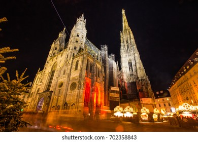 Atmospheric View, Blurred Motion of Vienna's Stephansdom with Christmas Night Market, Vienna (Wien), Austria, Europe. Landmark Night Light Illumination in special events, holidays, festivals concept.