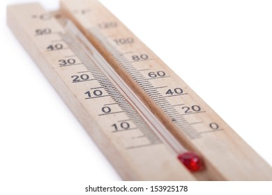 Atmospheric wooden thermometer closeup on white background