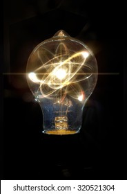 Atomic particle as lightbulb filament for nuclear energy imagery