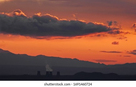 Atomic plant in Armenia at sunset with smoke
