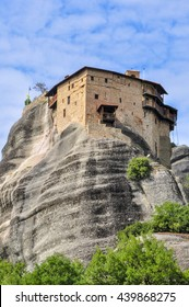Atop a steep cliff, is one of the six monasteries in Meteora. Greece