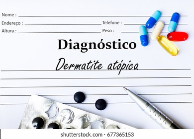 Atopic Dermatitis - Diagnosis written on a piece of white paper with medication and Pills ( Dermatite atópica in Portuguese language )