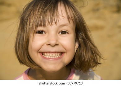 atractive smile of little girl