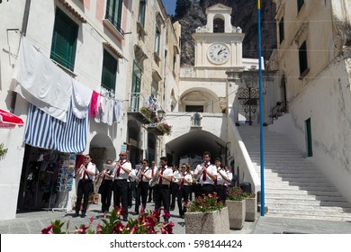 Atrani, Italy - July 10, 2016: The brass band plays music on Atrani Street.