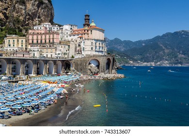 Atrani, Italy - July 2, 2016: The beach and the coast of the Salerno Bay. View of the church in Atrani.