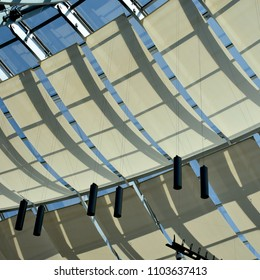 Atrium ceiling with windows and sail shades