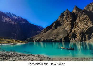 Attabad Lake, Gojal Valley, Hunza, Gilgit Baltistan, Pakistan formed after the 2010 Attabad Disaster and now a popular tourist attraction in a scenic landscape with majestic mountain peaks