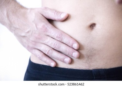 Attack of appendicitis. Pain in the right side. Attack of appendicitis. Pain in the right side of the abdomen, close-up image.
