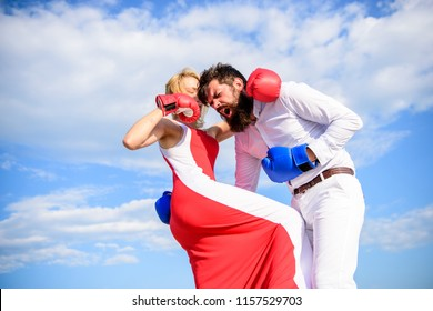 Attack is best defence. Defend your opinion in confrontation. Man and woman fight boxing gloves sky background. Female attack. Take course to be confident in safety. Pursue course of self defence.