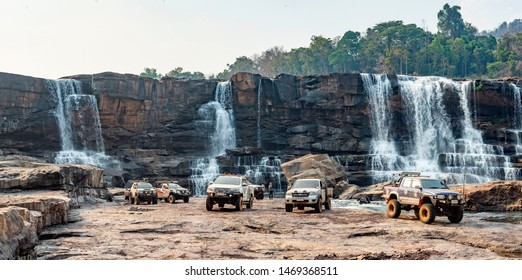 Attapue,Laos- March 22, 2019: Off-road caravans are taking pictures of the Xepha Water Fall during the dry season. With not much water.