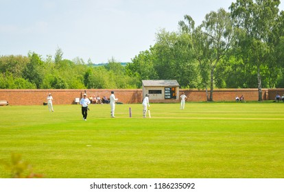 Attenborough, England - May 28, 2018: People play traditional cricket in the small village of Attenborough, Nottinghamshire, East Midlands, England