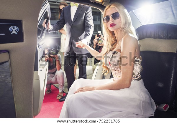 Attending the red carpet event by stepping out of the limousine at the night of the premiere
