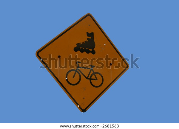 Attention Cyclists and rollerbladers sign on blue