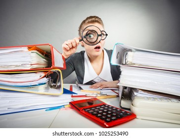 Attention paperwork corporate details workaholism concept. Crazy office lady at desk. Workaholic secretary holding magnifying glass.