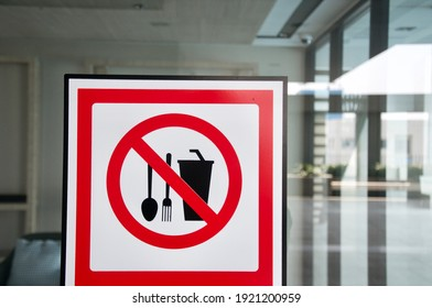 Attention Sign of food and drink not allowed bring from outside to restaurant. It is regulation from shopping mall. (Blurred background ) - Shutterstock ID 1921200959