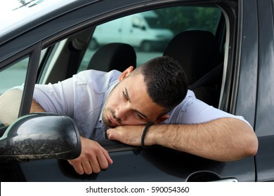 attention tired young man driving