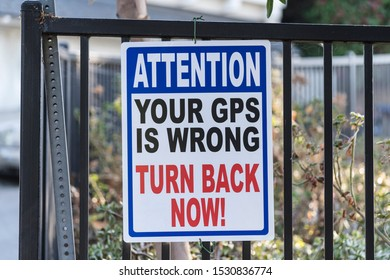 Attention your gps is wrong turn back now warning sign.