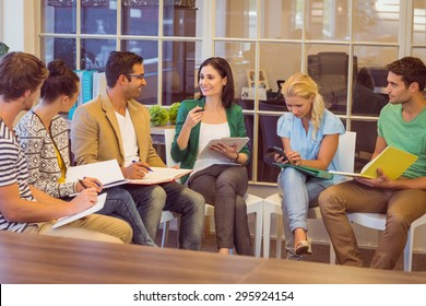 Attentive creative business people in meeting at office