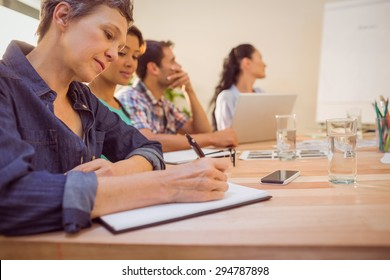 Attentive creative business team in a meeting at office