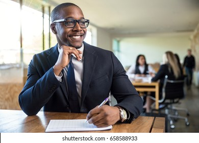Attentive enthusiastic new hire career worker employee taking notes listening with nice smile