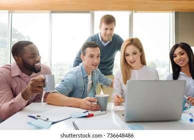 Attentive female person explaining news to her colleagues