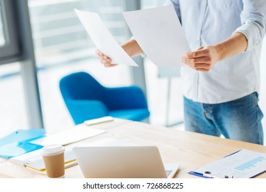 Attentive man checking both documents