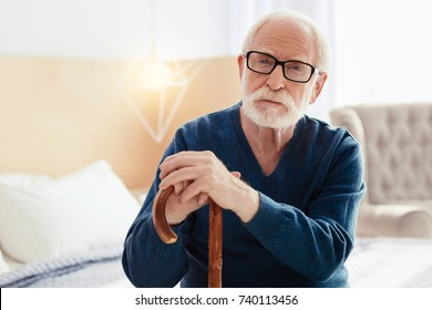 Attentive pensioner posing on camera