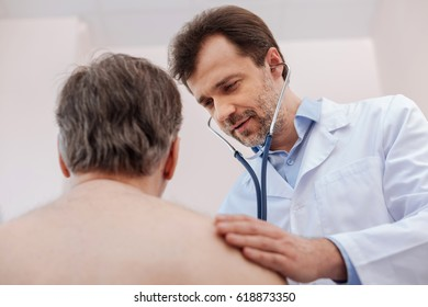 Attentive professional doctor testing lungs