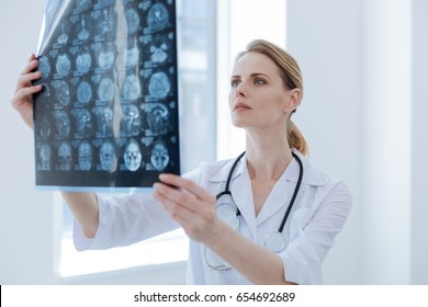 Attentive radiologist examining x ray at the clinic
