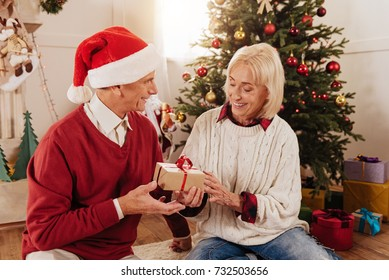 Attentive woman taking little present