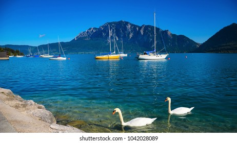 Attersee lake with boats and swans in Austiran Alps