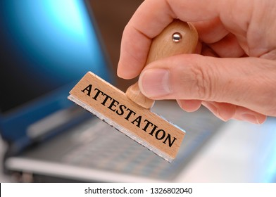attestation  printed on rubber stamp in hand