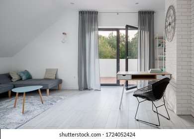 Attic room with balcony, desk to study and relax area with corner sofa