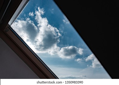 Attic. View from the window. View of the sky from the window. Skylight. Light in the house
