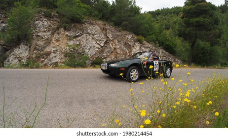 ATTICA, GREECE, MAY 15, 2021. Classic roadster car MAZDA MX5 made in Japan in 1994, during a classic car rally in a mountainous area close to Athens, Greece