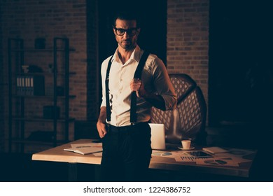 Attorney banker billionaire millionaire bristle man in classic chic formal wear stand inside loft industrial interior workplace in eyeglasses spectacles look at camera