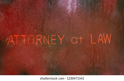 Attorney at Law Neon Sign in rainy window