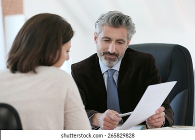 Attorney meeting client in office