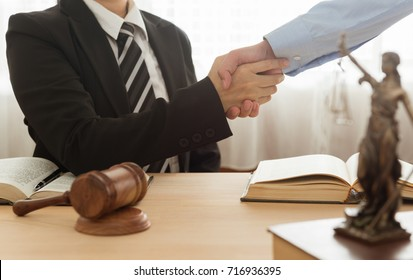 attorney shaking hand with businessmen and give legal advice at law office. legal services concept.