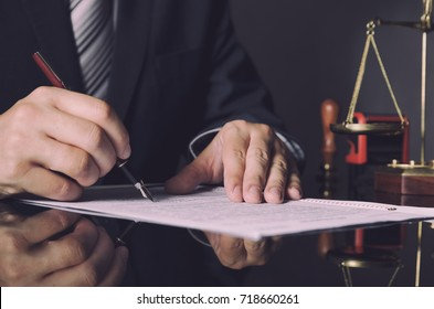 Attorney in suit working in office. law lawyer pen business man notary scale concept