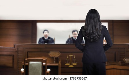 attorney woman on courtroom talking to magistrate in court box. for law and legal adjustment concept. The attorney communication on courtroom.